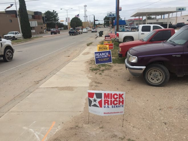 Campaign signs greet Carlsbad drivers on Greene Street Monday afternoon. Absentee voting is taking place right now and early voting starts Saturday.