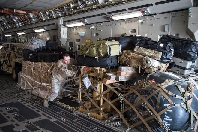 Senior Airman Clinton Andrews, 821st Contingency Response Support Squadron aerial porter, offloads cargo from a Travis Air Force Base C-17 Globemaster III at Tyndall Air Force Base, Florida, Oct. 12, 2018. The contingency response team deployed to assess damage and establish conditions for the re-initiation of airflow, bringing much needed equipment, supplies and personnel for the rebuilding of the base in the aftermath of Hurricane Michael. AMC equipment and personnel stand by across the nation to provide even more support upon request