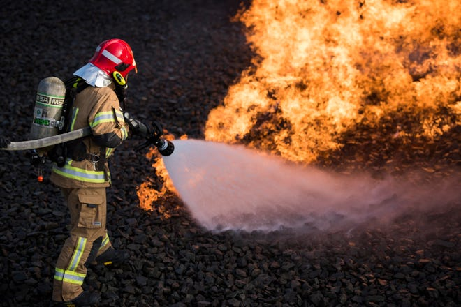 A Latvian air force firefighter extinguishes a simulated fire during a U.S. Air Forces in Europe NATO Firefighter Partnership course on Ramstein Air Base, Germany, Oct. 10, 2018. The course enabled NATO allies to train together using NATO crash and fire procedures in a simulated environment.