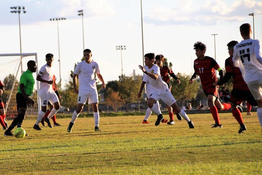 Keanu Tran runs to recover the loose ball in the midfield in the 1 to 0 Win over the Centennial Hawks on Oct. 9.