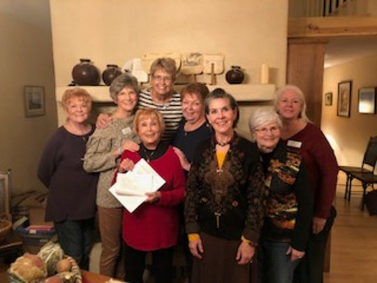 Ruidoso Altrusa members hold a copy of their contract with LCMC fr low-cost mammograms.