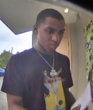 This ATM photo shows a suspect wanted by Bloomfield Township Police for attempting a bank fraud.