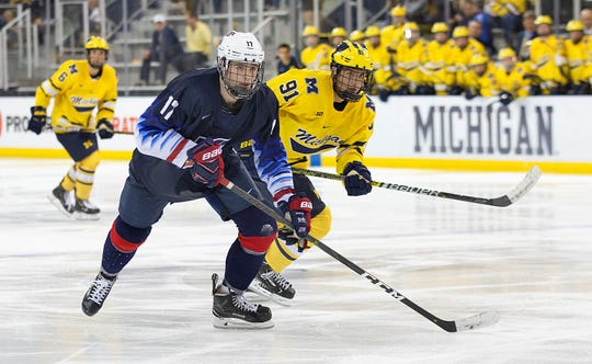 The pipeline between USA Hockey's NTDP and Michigan Hockey continues. One of the players on the Under-18 team who has committed to play next year at University of Michigan is forward John Beecher (17), skating during Friday's game at Yost Ice Arena. At right for the Wolverines is former NTDP player Nick Pastujov (91).