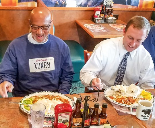 Horace Roberts enjoys his first meal as a free man next to his attorney, Michael Semanchik of the California Innocence Project.