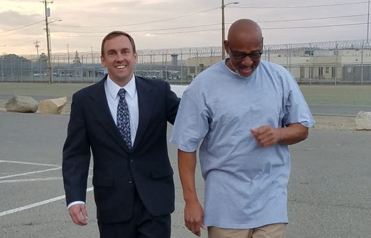 Horace Roberts walks with California Innocence Project attorney Michael Semanchik after 20 years of wrongful incarceration.