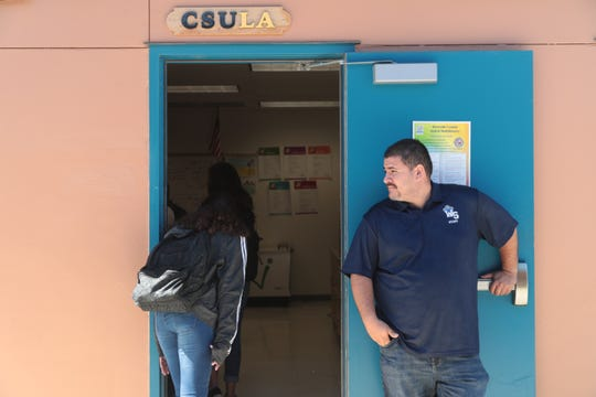 Luis Martinez holds the door open for students entering his Spanish class at West Shores High School, Salton City, Calif., September 10, 2018.
