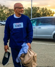 Horace Roberts walks out of prison after 20 years of wrongful incarceration holding all of his belongings.