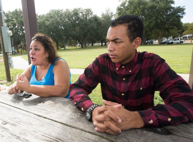 Diana Muniz-Walls and her son, Jaiden Muniz-Walls, talk Monday about a batteryat Pensacola Catholic High School that left the teenager with injuries, including a black eye, eye socket damage and a broken nose.