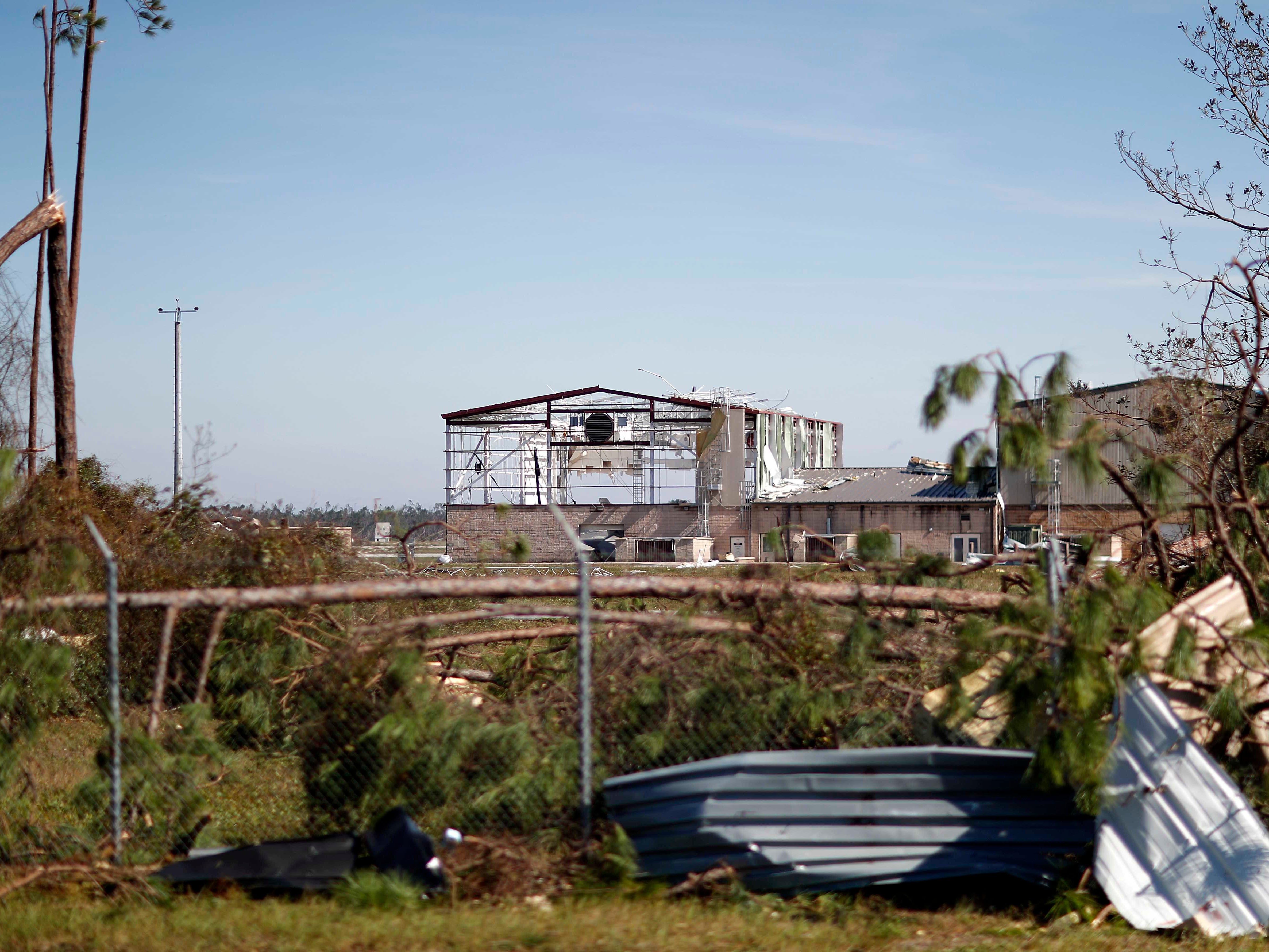 An airplane hanger at Tyndall Air Force Base is damaged from hurricane Michael in Panama City, Fla., Thursday, Oct. 11, 2018. The devastation inflicted by Hurricane Michael came into focus Thursday with rows upon rows of homes found smashed to pieces, and rescue crews began making their way into the stricken areas in hopes of accounting for hundreds of people who may have stayed behind.