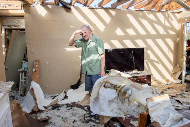 Ken Brown looks at the damage inside his house for the first time since Hurricane Michael in the Calloway area of Panama City, Florida on Monday, October 15, 2018.