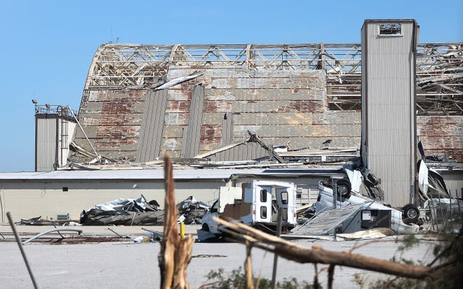 A damaged airplane hanger is seen on the grounds of Tyndall Air Force Base after Hurricane Michael passed through the area on Oct. 12.