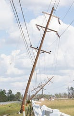 A line of utility lines are brokend and falling over after Hurricane Michael in Panama City, Florida on Monday, October 15, 2018.
