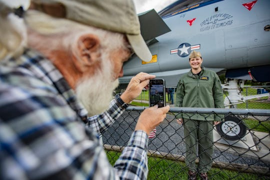 David F. Brown, a VFW member and restoration project participant, photographs Cdr. Stacey L. Uttecht Saturday, Oct. 13, 2018 in East Berlin.