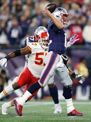 Oct 14, 2018; Foxborough, MA, USA;  Kansas City Chiefs linebacker Breeland Speaks (57) pressures New England Patriots quarterback Tom Brady (12)  during the fourth quarter at Gillette Stadium. Mandatory Credit: Greg M. Cooper-USA TODAY Sports
