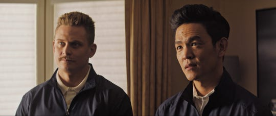 "Billy Magnussen (left) and John Cho star in ""The Oath."""