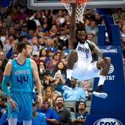 Dallas Mavericks' DeAndre Jordan (6) hangs from the rim after a dunk against the Charlotte Hornets during the second half of an NBA preseason basketball game Friday, Oct. 12, 2018, in Dallas. (AP Photo/Cooper Neill)