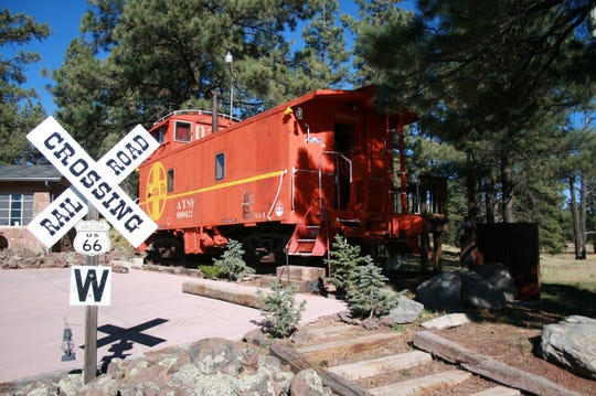 Visitors can sleep in a caboose at Canyon Motel and RV Park in Williams.