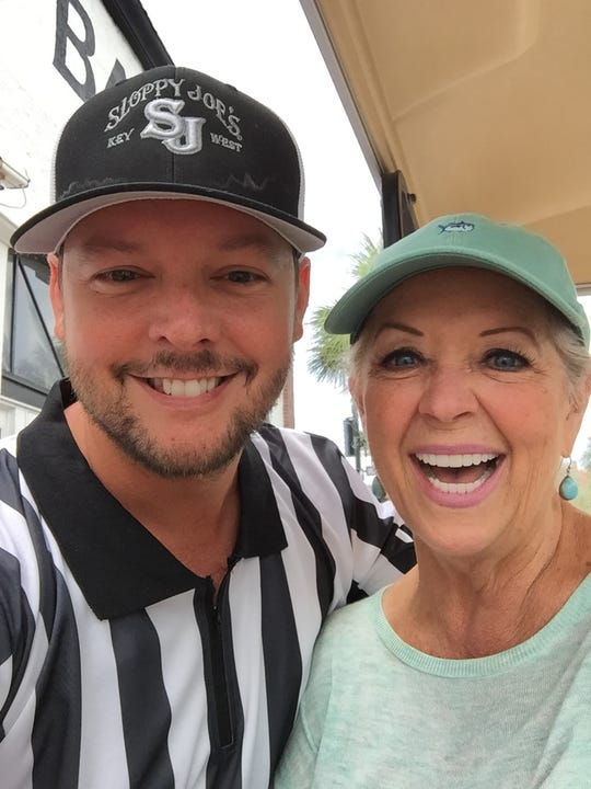 Port Clinton native Mark Gardner poses with celebrity chef Paula Deen, who was a featured guest at Sloppy Joe's in Key West, where Gardner works as floor, beverage, and entertainment manager.