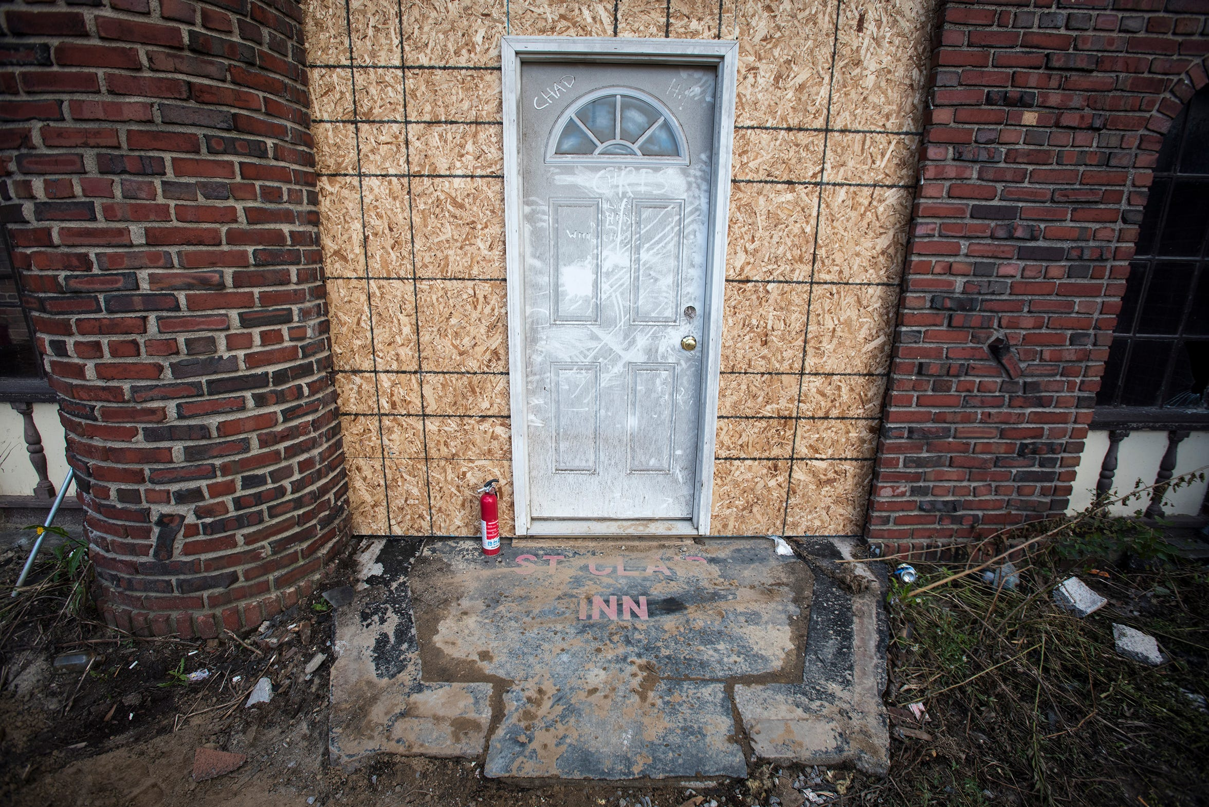 A dusty doormat sits at the foot of a makeshift front door at the St. Clair Inn as construction progresses.