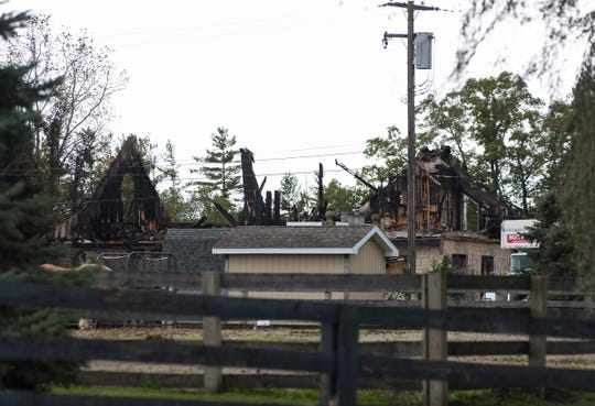 The remains of a house near Gratiot and Rattle Run roads in St. Clair Township that burned in a fire Saturday.