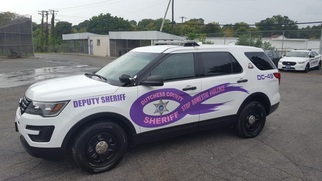 A Dutchess County Sheriff's Office patrol vehicle has been lettered and painted in support of domestic violence victims and awareness.