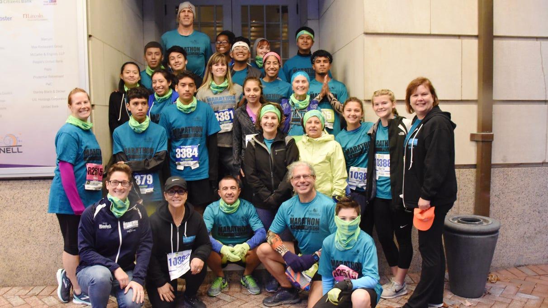 Marathon Project participants pose together on Saturday at the Hartford Marathon.