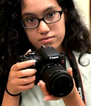 York County School of Technology junior Angela Gonzalez shoots photos during class at the school Friday, October 12, 2018. She is studying in the school's International Baccalaureate Career-related Program. In the future she hopes to use her skills working in film. Bill Kalina photo
