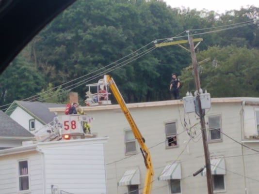 Painter shocked by electric wire while 50-75 feet in the air