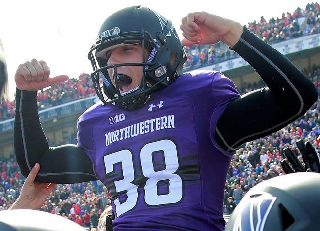 Northwestern's Drew Luckenbaugh (38) celebrates his game-winning field goal in overtime against Nebraska on Saturday in Evanston, Illinois. Luckenbaugh is a Spring Grove High School graduate. (AP Photo/Jim Young)