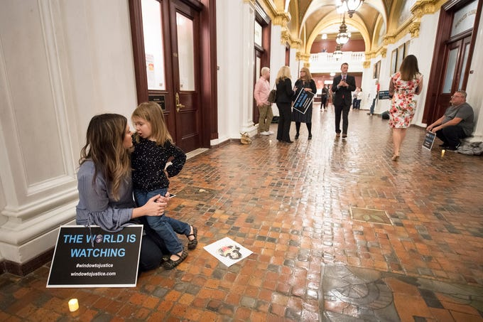 Adrienne Doolan, left, a victim of non-clergy sexual abuse in Hanover, holds her daughter Reagan, age 4, during the demonstration for statute of limitations reform to the state's childhood sexual abuse laws at the state capitol in Harrisburg Monday October, 15, 2018. Doolan said that she wanted her daughter to understand that she should speak up immediately if someone harmed her.