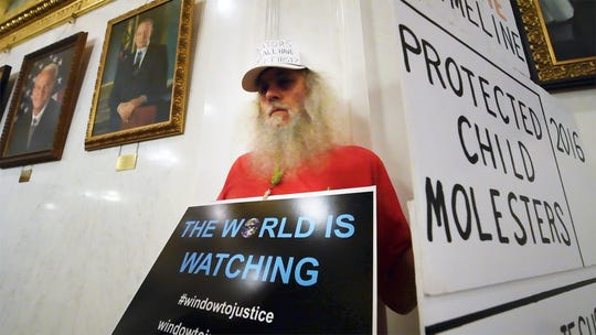 Dave Kohler, who said he was abused by an ordained minister in the Jehovah's Witnesses in Kutztown and Emmaus, talks about his experience, during the demonstration for statute of limitations reform to the state's childhood sexual abuse laws at the state capitol in Harrisburg on Monday.