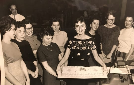 When Annemarie Eggstein Baker became a citizen of the United States her co-workers at Caterpillar celebrated the occasion with the cake Annemarie is holding.