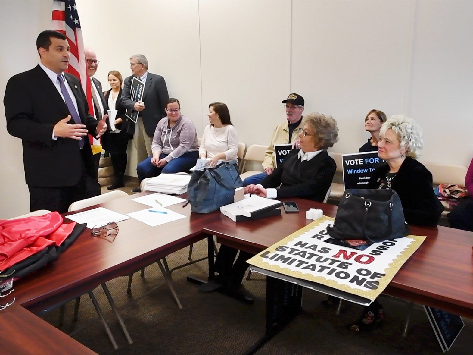 State Rep. Mark Rozzi, left, addresses advocates for statute of limitations reform to the state's childhood sexual abuse laws at the state capitol in Harrisburg Monday October, 15, 2018.