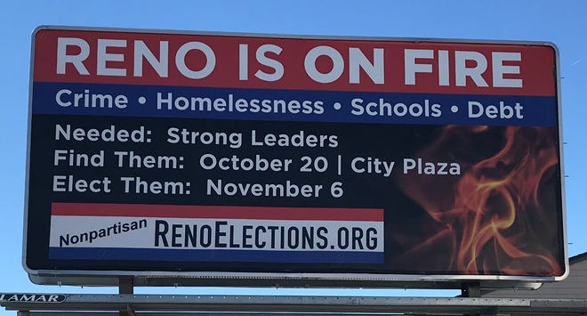 A billboard for RenoElections.org touts the group's Saturday debate.