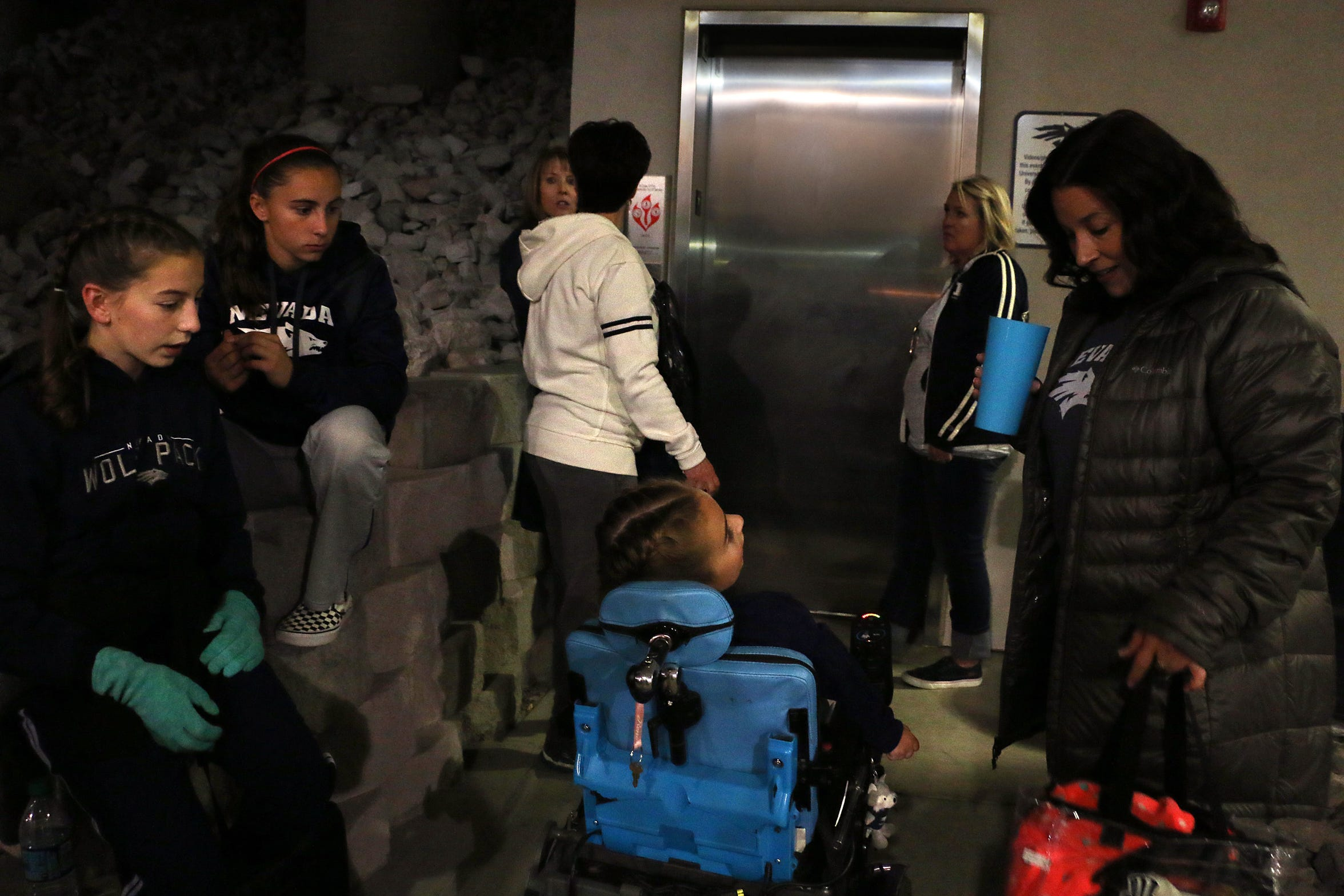 Ella Marini,7, in wheelchair, and her family make their way into Mackay Stadium to see Nevada take on Boise St. in Reno on Oct. 13, 2018.