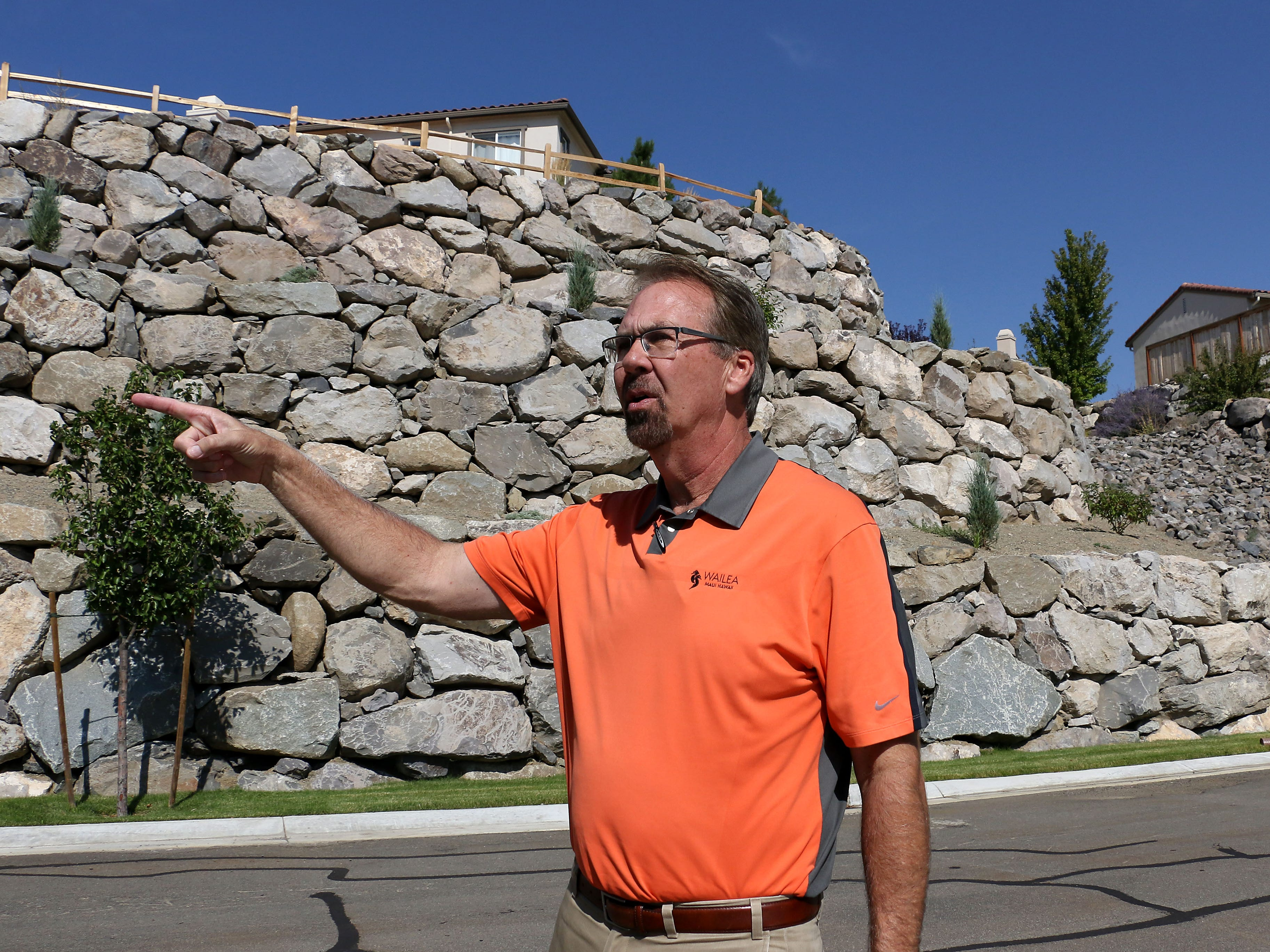 Real estate agent Dave Hughes shows the RGJ a rock wall in the Somersett master planned community in Reno on Aug. 29, 2018.