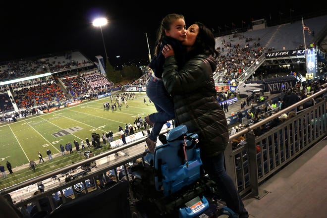 Ella Marini gets carried to her seat in Mackay Stadium to see Nevada take on Boise St. in Reno on Oct. 13, 2018.