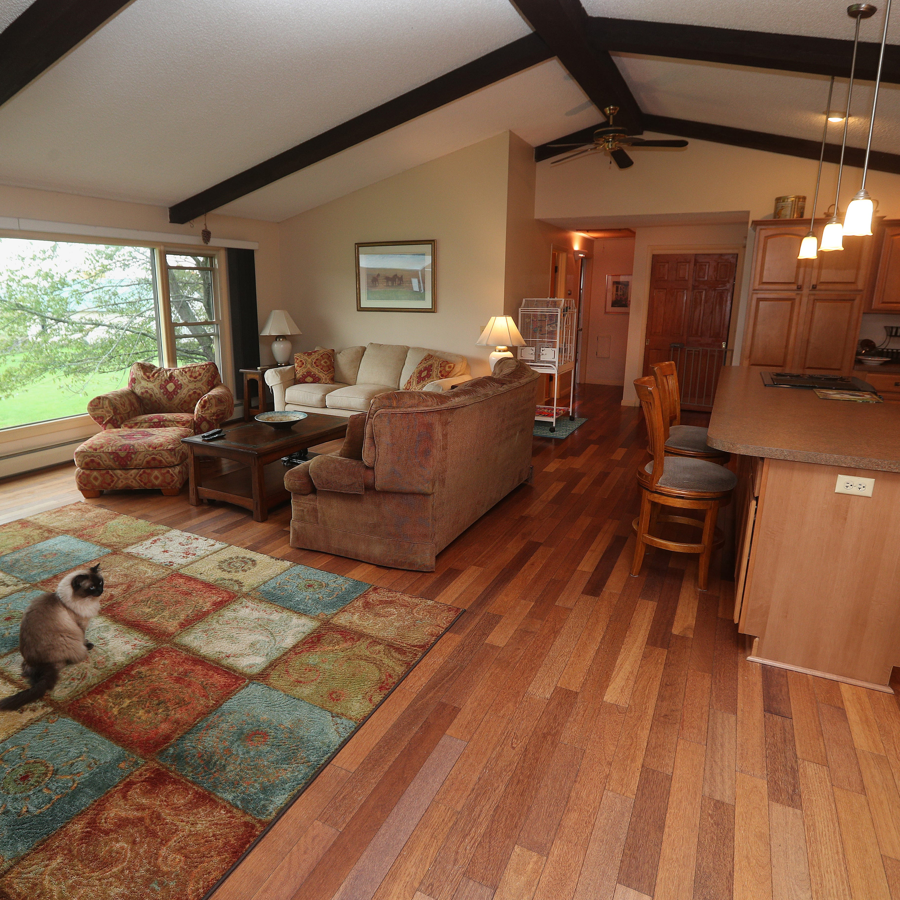 Exposed wood beams accentuate the open floor plan.