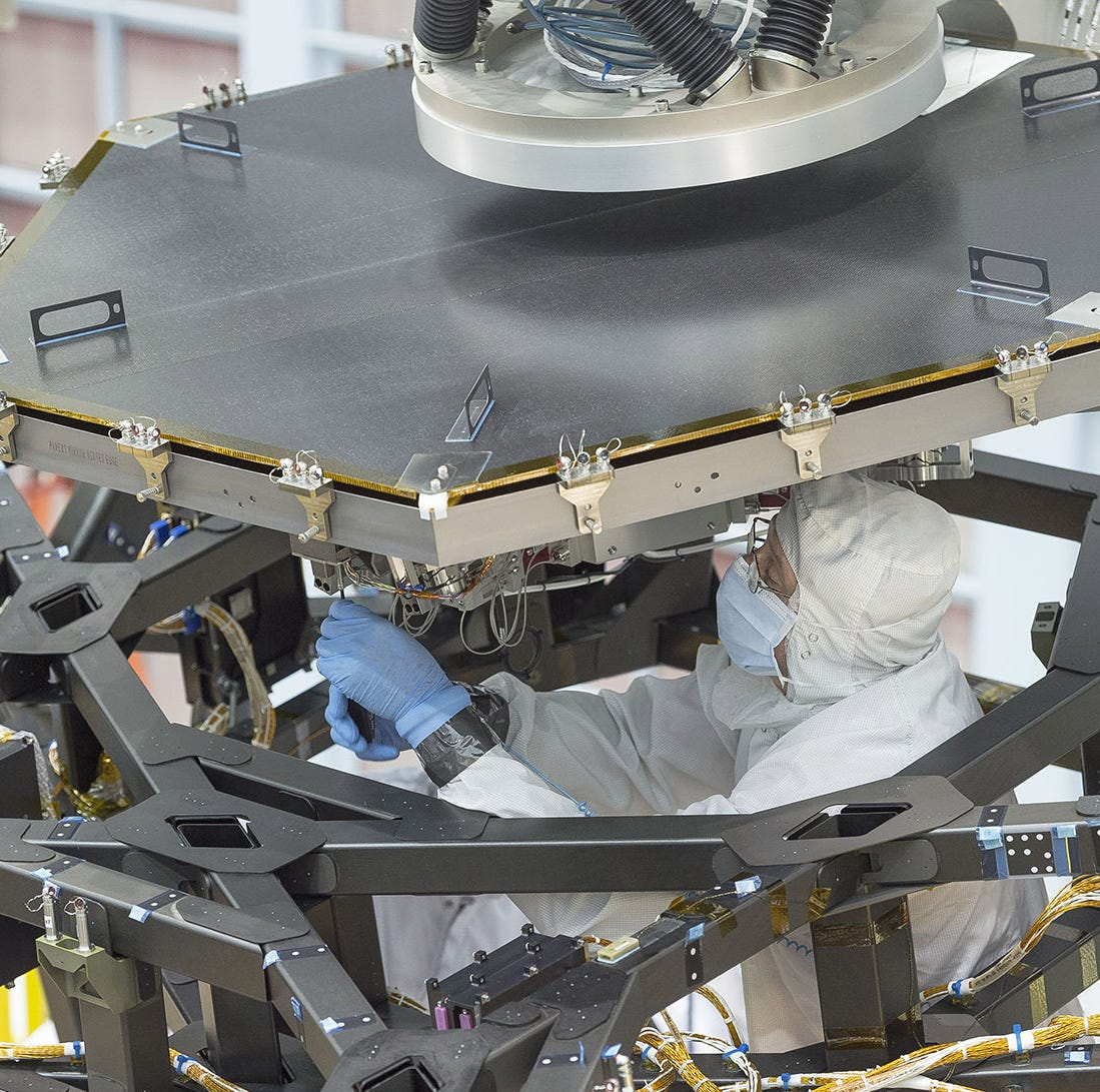 2016 File photo: Rochester-based Harris Corp. employees working on a NASA telescope.