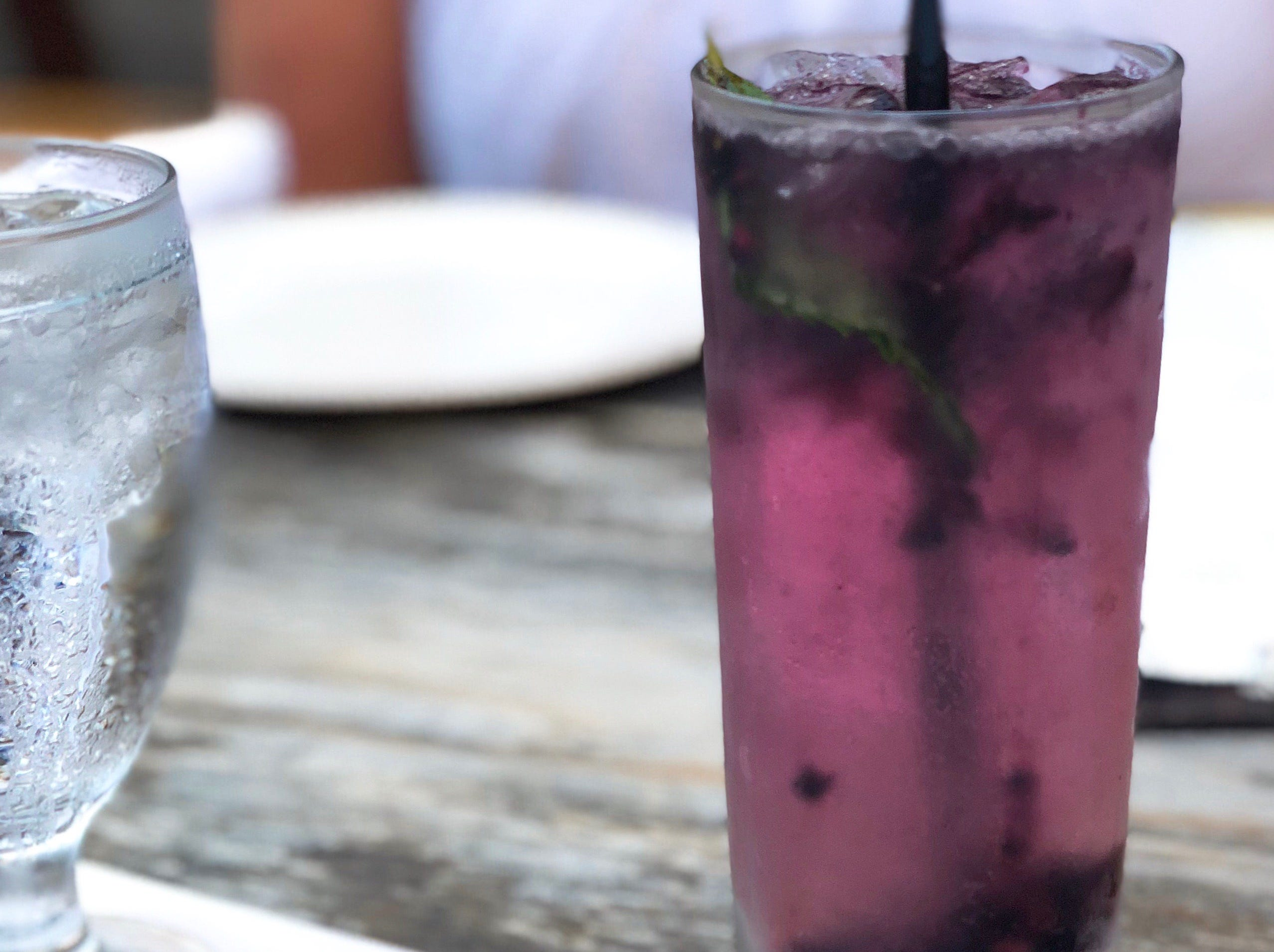 The King Sue Ii Cocktail special contains local blackberries, vodka, St. Germain and mint topped with sparkling wine.