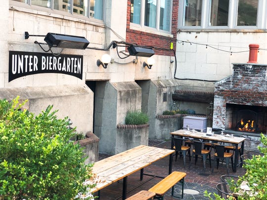 The outdoor fireplace is an inviting focal point of the sunken patio at Unter Biergarten on East Avenue in the heart of Rochester's East End.