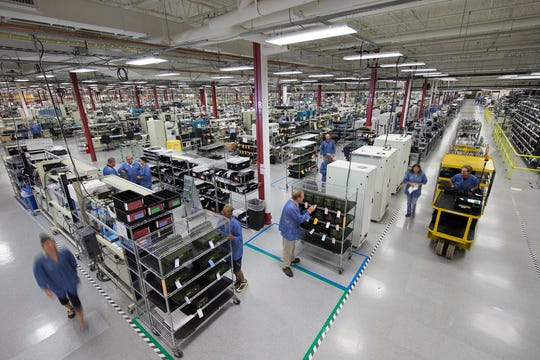 Employees whir around Harris Corp.'s Jefferson Road facility.