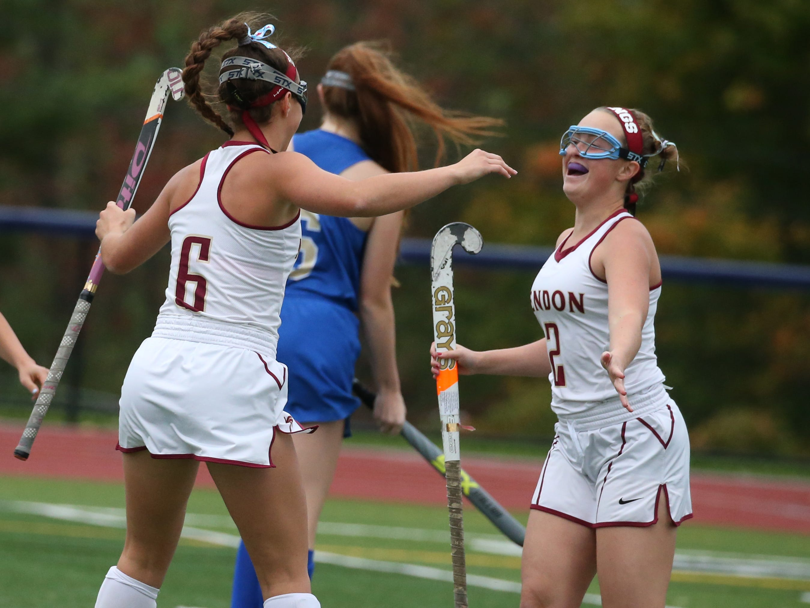 Mendon's Kyra Lucey, left, celebrates her first goal of the game with teammate Anya Lucey, right.