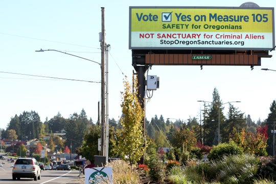 "A billboard in favor of Measure 105, an effort to end Oregon's ""sanctuary state"" law, is shown on Monday, Oct. 15 in South Salem."