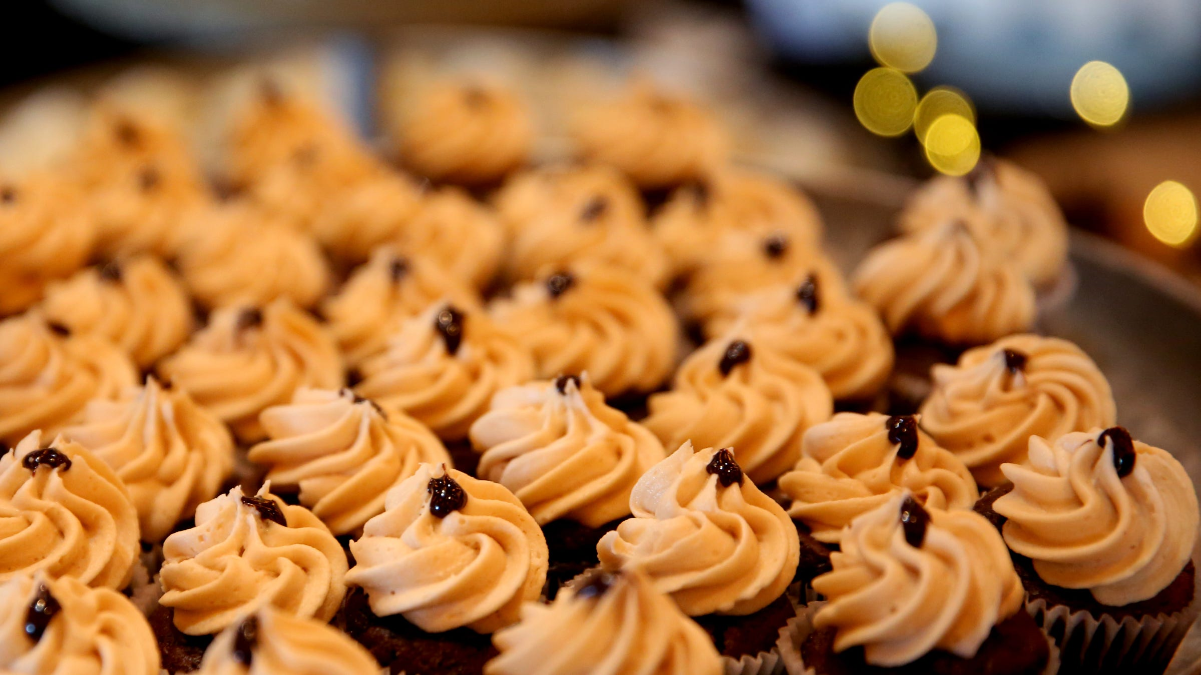 Chocolate cupcakes topped with peanut butter buttercream are offered by Sweetly Baked during the 20th annual Chef's Nite Out, a fundraiser benefiting the Marion-Polk Food Share, at the Salem Convention Center on Sunday, Oct. 14, 2018.