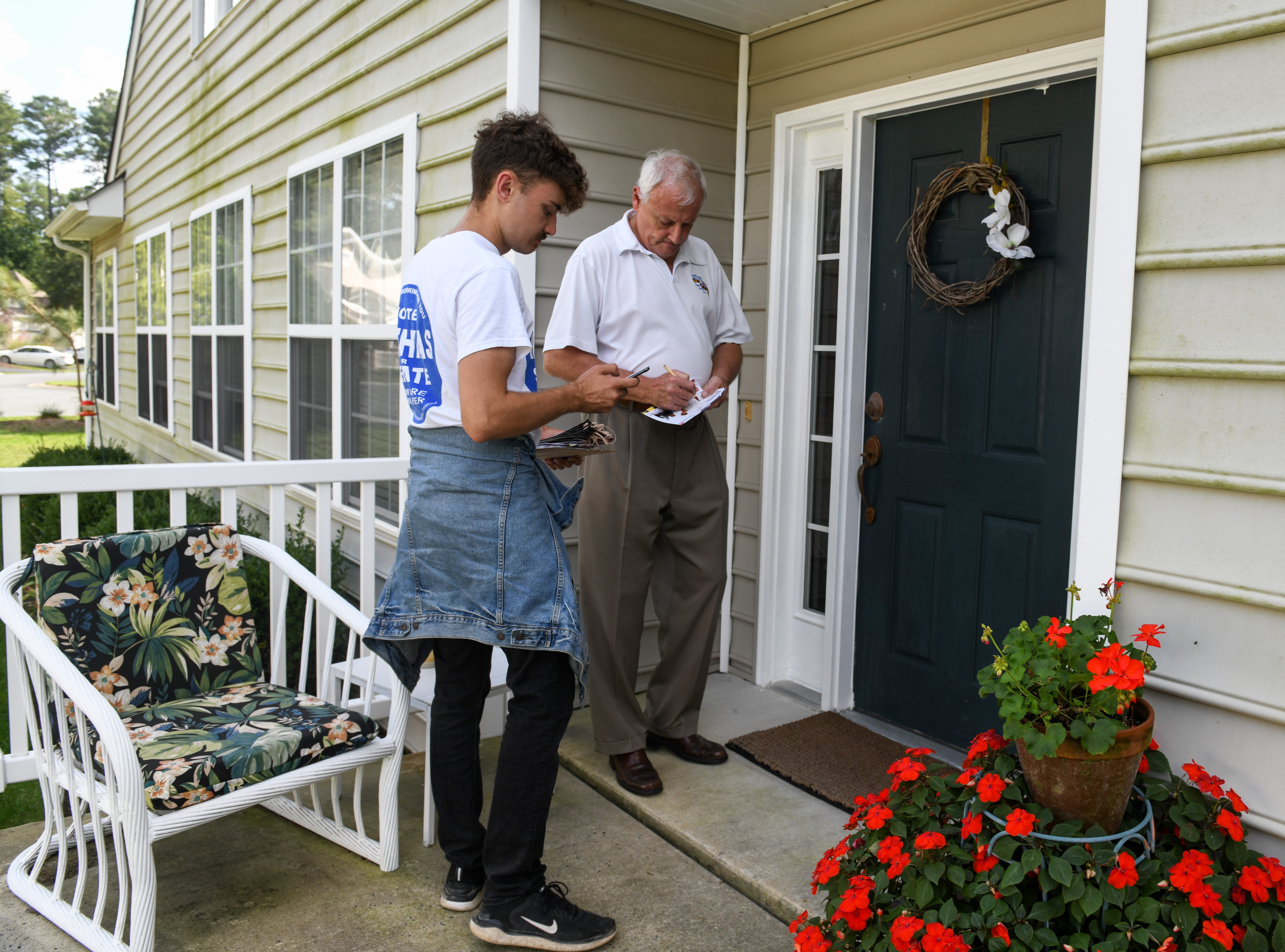 Sen. Jim Mathias, Democratic incumbent candidate for Maryland State Senate in District 38, leaves a note for a voter in Ocean Pines while campaigning with staffer Andrew Wilson on Tuesday, Oct 2, 2018.