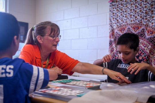 Teacher Mindy Demaris teaches letter sounds to visually impaired twins Adam (right) and Aaron Shrieves at Glen Avenue Elementary School in Salisbury, Maryland on Monday, Sept 17, 2018.