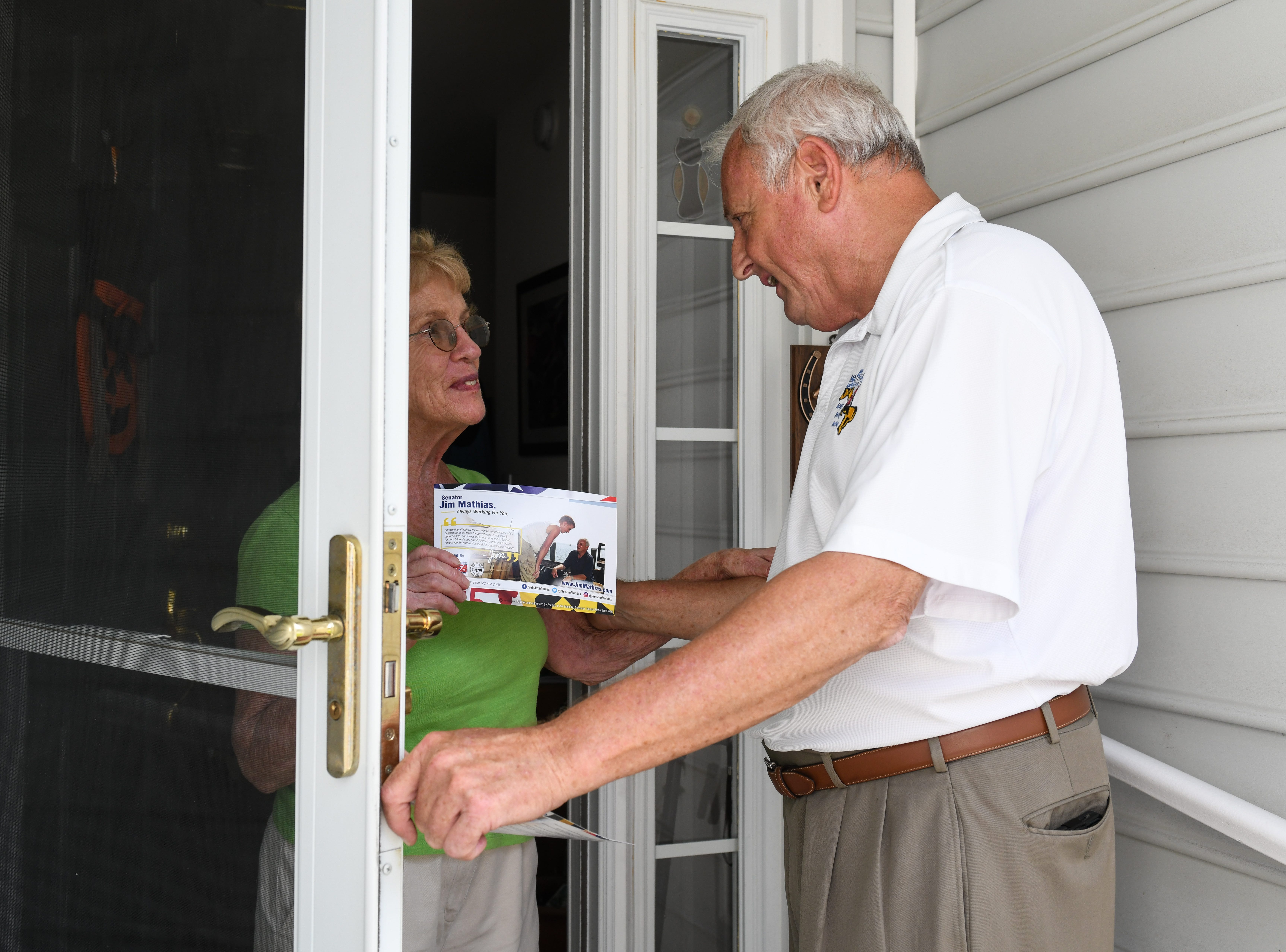 Sen. Jim Mathias, Democratic incumbent candidate for Maryland State Senate in District 38, talks to voter Elizabeth Watson in Ocean Pines while campaigning on Tuesday, Oct 2, 2018.