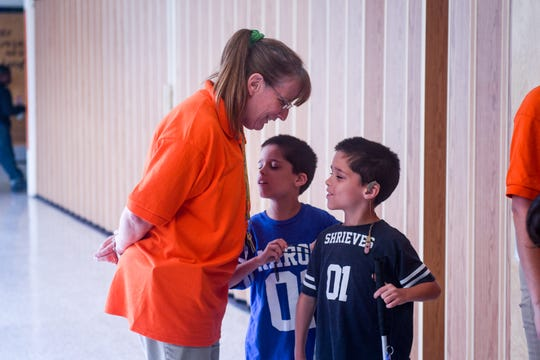 Teacher Mindy Demaris helps visually impaired twins Adam (right) and Aaron Shrieves to the lunchroom at Glen Avenue Elementary School in Salisbury, Maryland on Monday, Sept 17, 2018.
