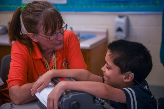 Teacher Mindy Demaris helps Adam Shrieves, a visually impaired student, write in braille at Glen Avenue Elementary School in Salisbury, Maryland on Monday, Sept 17, 2018.